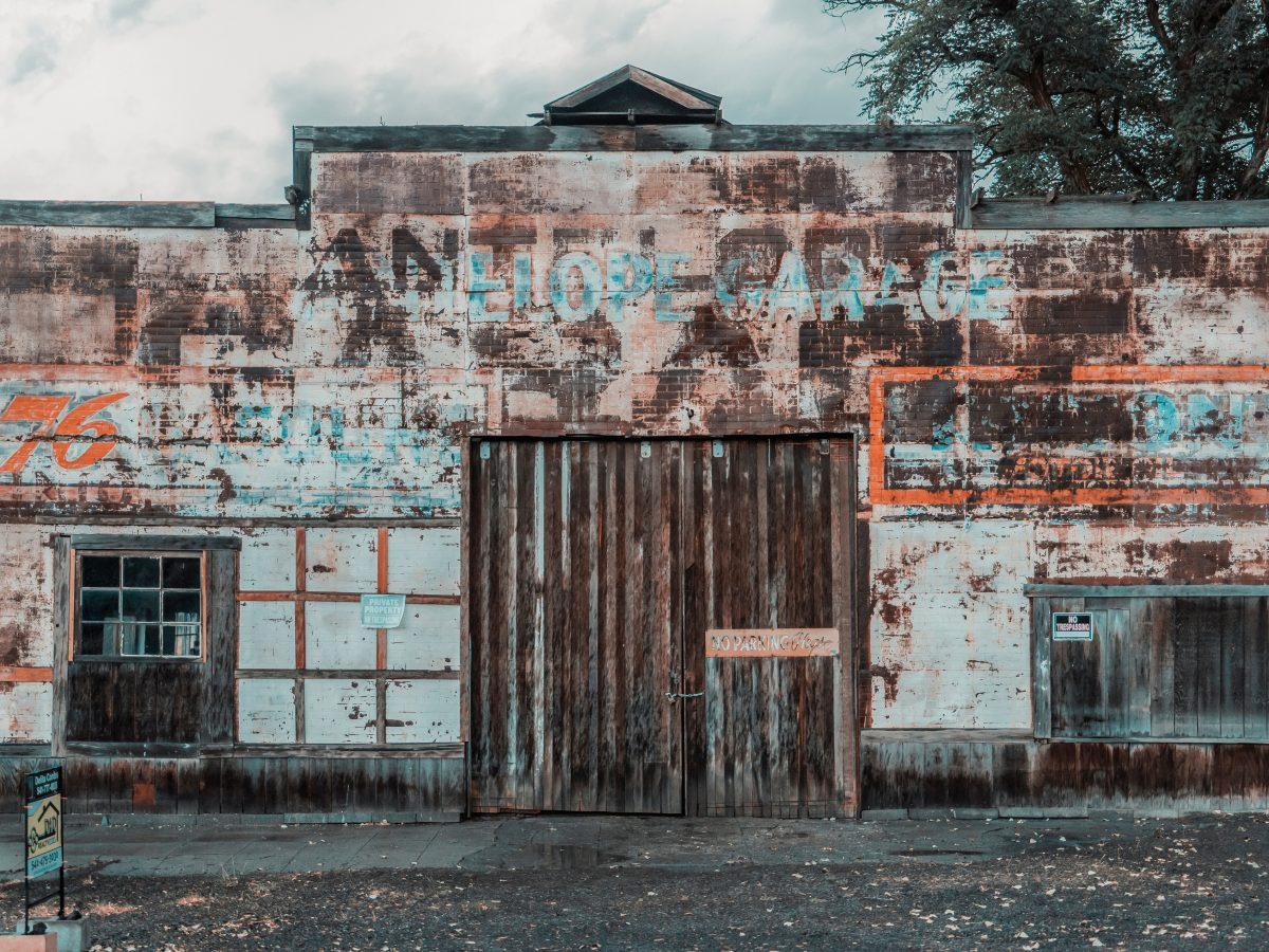 Photo of a shuttered business store front.